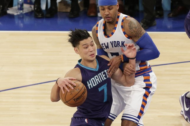 Charlotte Hornets Jeremy Lin makes contact with New York Knicks Carmelo Anthony when he drives to the basket in the second half at Madison Square Garden in New York City on November 17, 2015. Photo by John Angelillo/UPI