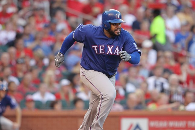 Texas Rangers' Prince Fielder tries to run out a ball hit on the ground in the second inning at Busch Stadium in St. Louis on June 17, 2016. Photo by Bill Greenblatt/UPI