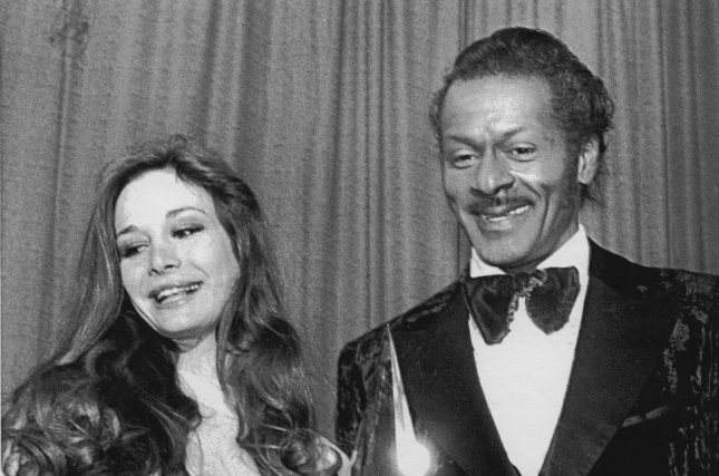 Legendary rock 'n' roll pioneer Chuck Berry receives a distinguished Merit Award at the American Music Awards in 1981. Berry died Saturday at his home in suburban St. Louis. He was 90. File photo by Bill Hormell/UPI