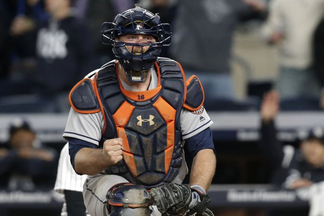 Houston Astros catcher Brian McCann celebrates after tagging out New York Yankees' Jacoby Ellsbury at the plate. File photo by John Angelillo/UPI