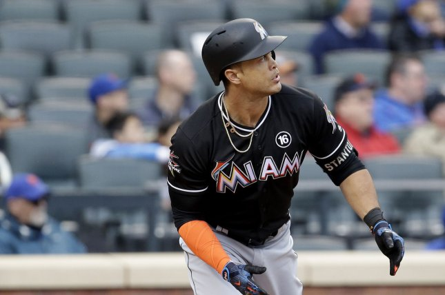 Miami Marlins' Giancarlo Stanton hits a home run. Stanton set the Marlins' franchise RBI record Friday night. File photo by John Angelillo/UPI