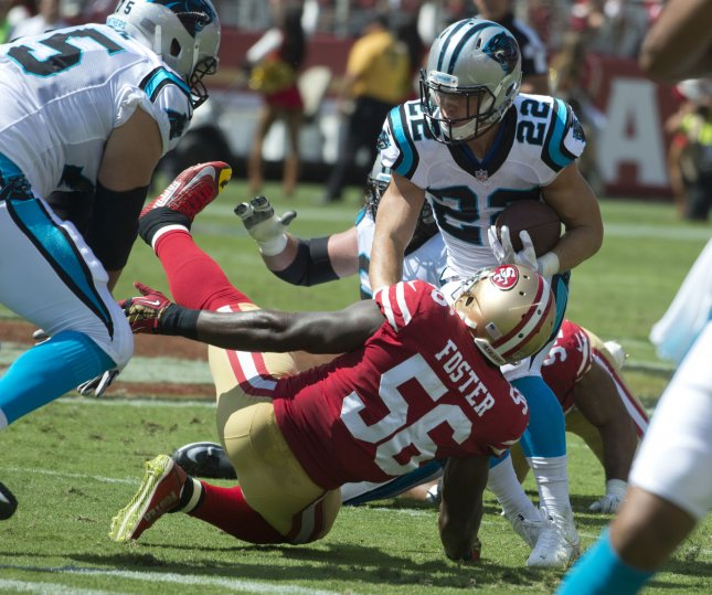 San Francisco 49ers first-round draft choice and linebacker Reuben Foster twists his ankle while attempting a tackle in Sunday's loss to the Carolina Panthers. Photo by Terry Schmitt/UPI