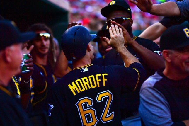 Pittsburgh Pirates second baseman Max Moroff (62) is congratulated after scoring off of a Jacob Stallings RBI single in the first inning Sunday at Nationals Park in Washington, D.C. Photo by Kevin Dietsch/UPI