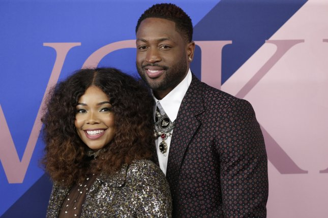 Gabrielle Union (L) and Dwayne Wade attend the CFDA Fashion Awards on June 5. The actress opens up about her fertility struggles in her book, We're Going to Need More Wine. File Photo by John Angelillo/UPI