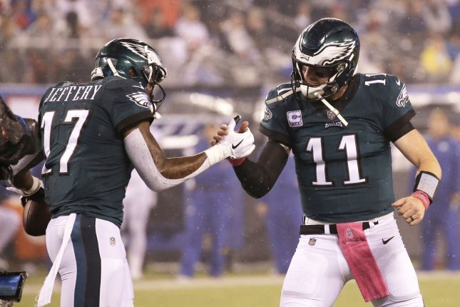 Philadelphia Eagles quarterback Carson Wentz (11) and receiver Alshon Jeffery (17) celebrate a first-quarter touchdown against the New York Giants in Week 6 of the NFL season on Thursday at MetLife Stadium in East Rutherford, New Jersey. Photo by John Angelillo/UPI