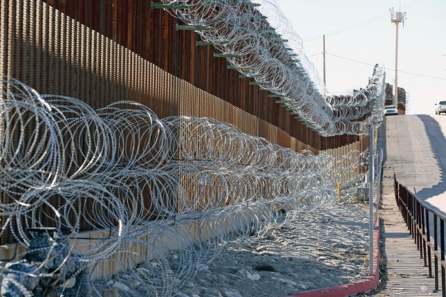 Environmentalists say that concertina wire like the type pictured in Nogales, Ariz., placed along the U.S.-Mexico border endangers rare wildlife like wolves and jaguars. File Photo by Art Foxall/UPI