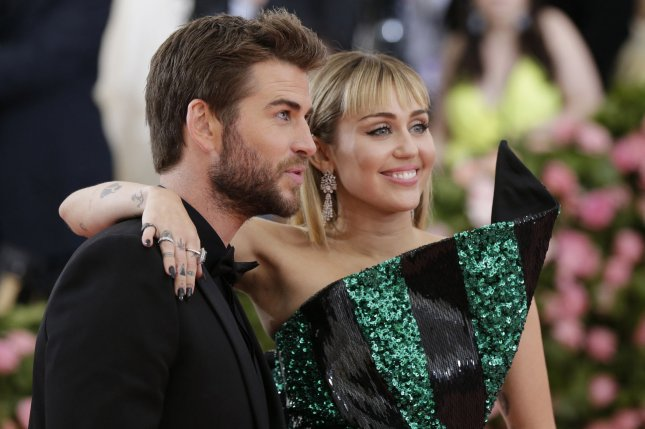 Miley Cyrus (R), pictured with Liam Hemsworth, will take the stage at the iHeartRadio Music Festival in September. File Photo by John Angelillo/UPI