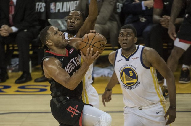 Houston Rockets guard Eric Gordon (10) had an MRI on Tuesday that revealed significant debris in his right knee. File Photo by Terry Schmitt/UPI