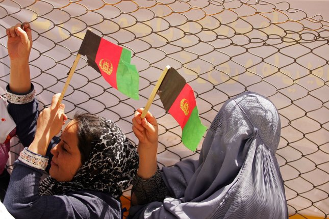 Supporters of Afghani President Hamid Karzai wave Afghan national flags during his campaign tour to Herat, Afghanistan on August 14, 2009. UPI/Mohammad Kheirkhah
