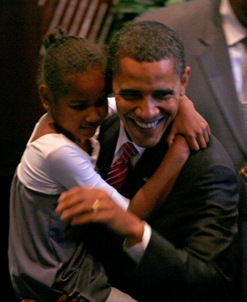 Democratic presidential hopeful Sen. Barack Obama (R) carries out his daughter Sasha, 7, after addressing congregants at the Apostolic Church of God in Chicago on June 15, 2008. Obama discussed the importance of fatherhood in his address to the church. (UPI Photo/Brian Kersey)