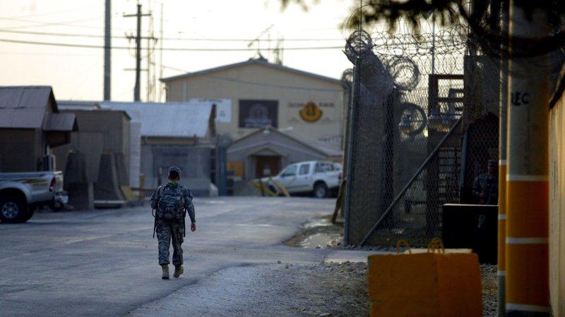 A U.S. service member walks along a road at the main U.S. base in Bagram, north of Kabul, Afghanistan. File/ UPI/Mohammad Kheirkhah