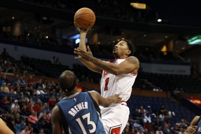 Chicago Bulls Derrick Rose stops for a jump shot in front of Minnesota  Timberwolves Corey Brewer in the first quarter at the Scottrade Center in St.  Louis ... 3d4183bb5ab0