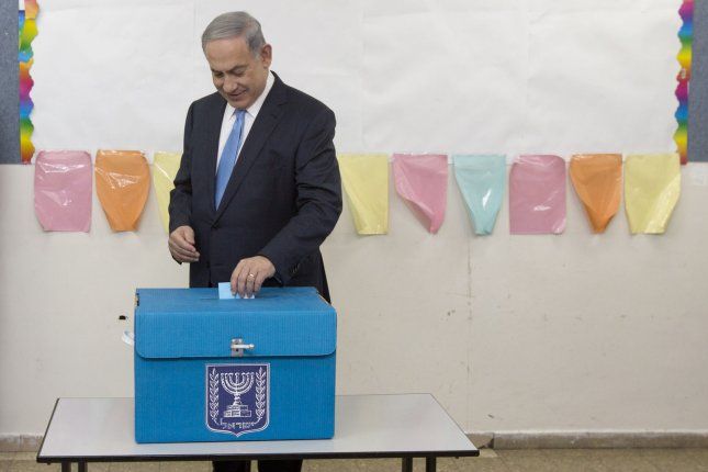 Israeli Prime Minister Benjamin Netanyahu casts his vote during Israel's parliamentary elections in Jerusalem, Tuesday, March 17, 2015. Photo by Sebastian Scheiner /UPI.