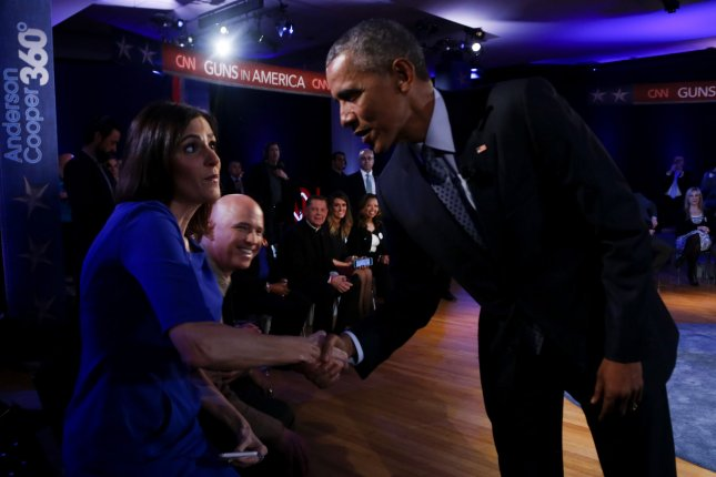 U.S. President Barack Obama shakes hands with Taya Kyle, widow of U.S. Navy SEAL Chris Kyle, during a commercial break of a live town hall event with CNN's Anderson Cooper on reducing gun violence in America at George Mason University in Fairfax, Va., on Thursday. Obama has promised to be a single-issue voter on gun control when it comes to the upcoming presidential election, though his chief of staff Sunday said the president will not endorse a candidate in the Democratic primary. Pool Photo by Aude Guerrucci/UPI