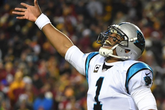 Carolina Panthers quarterback Cam Newton (1) celebrates after throwing a 30-yard touchdown pass to Ted Ginn Jr. against the Washington Redskins in the first quarter at FedEx Field on December 16 in Landover, Md. Photo by Kevin Dietsch/UPI