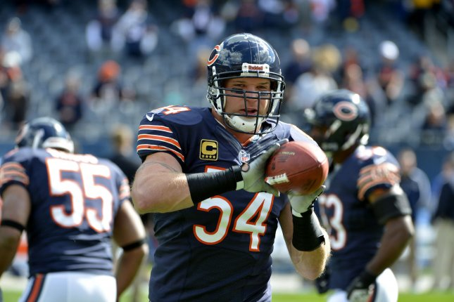 Former Chicago Bears middle linebacker Brian Urlacher warms up before the game against the then-St. Louis Rams on September 23, 2012 at Soldier Field in Chicago. File photo by Brian Kersey/UPI