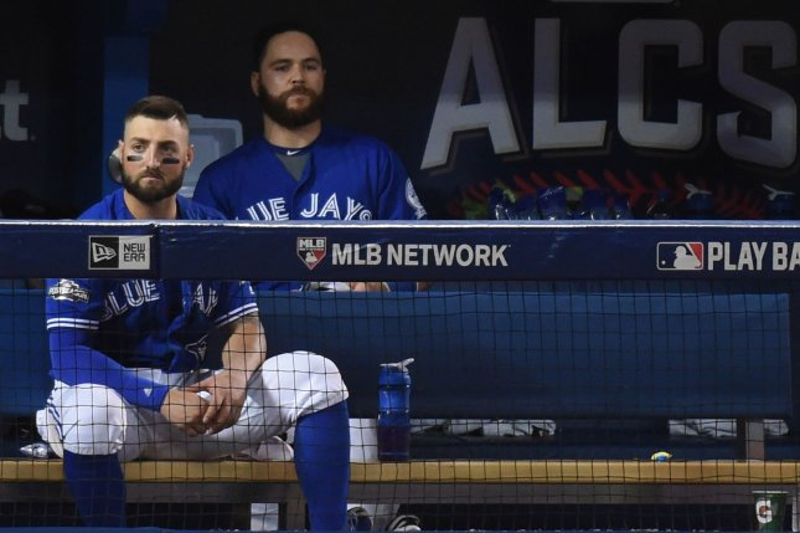 Toronto Blue Jays center fielder Kevin Pillar (L) and catcher Russell Martin. Photo by Darren Calabrese/UPI