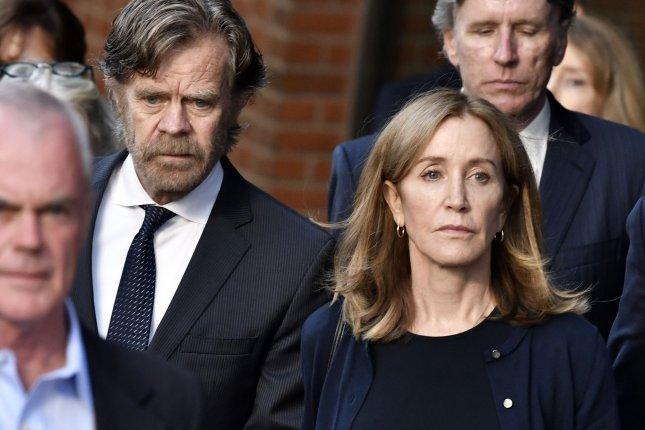 Actress Felicity Huffman, center right, leaves her sentencing with her husband William H. Macy, center left, at the John Joseph Moakley United States Courthouse in Boston on Friday. Photo by Josh Reynolds/UPI