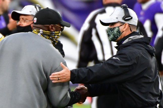 Pittsburgh head coach Mike Tomlin (L) and the Steelers beat John Harbaugh and the Baltimore Ravens 28-24 in the teams' first meeting earlier this month. File Photo by David Tulis/UPI
