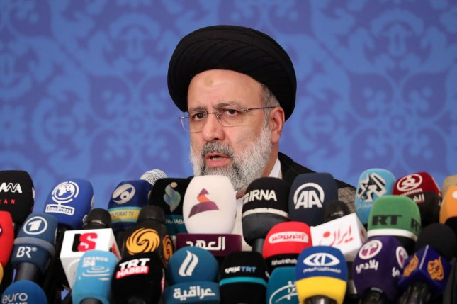 Iran's new President-elect Ebrahim Raisi speaks Monday during a press conference in Tehran, Iran where the hardline judiciary chief and Western critic said he would not be willing to meet President Joe Biden. Photo by Maryam Rahmanian/UPI