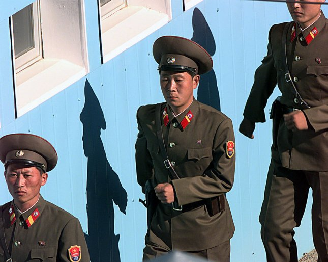 This undated Department of Defense photo shows members of the North Korean People's Army guards marching in formation to their appointed posts during a ceremony in the Panmunjom, South Korea. On Monday, May 25, 2009 North Korea allegedly detonated a nuclear device during an underground test and test fired several short range missile. North Korea announced that it has restarted its nuclear weapons research program. (UPI Photo/James Mossman/USAF)