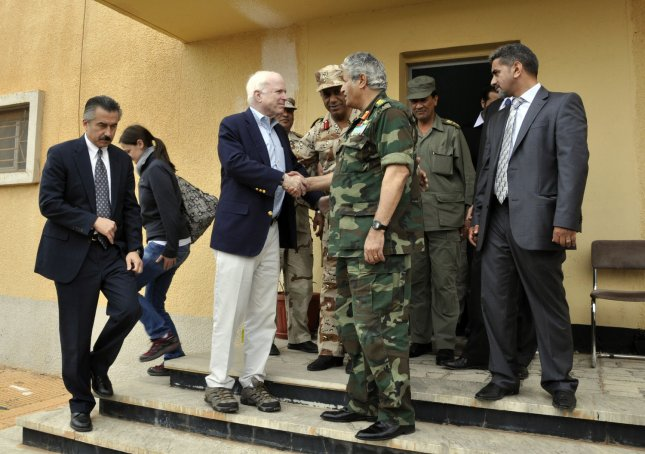 US Sen. John McCain, R-AZ, (C- left) is greeted by late Libyan rebel military leader Abdel-Fattah Younis ( C- Right) during his visiting to their headquarters in their eastern stronghold city of Benghazi on April 22, 2011. McCain urged the international community to recognise the rebels' Transitional National Council (TNC) as the legitimate voice of the Libyan people.UPI\Tarek Alhuony