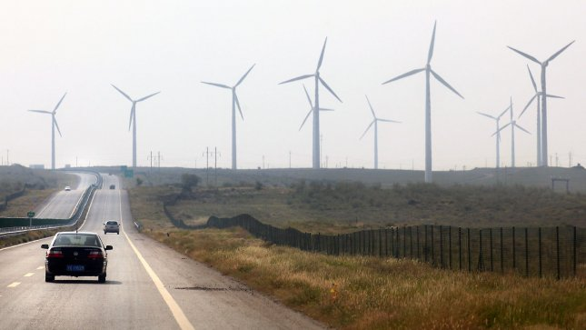 Massive wind turbines operate in the Taiyangshan Development Zone in Wuzhong, a frontier city in the northwestern province Ningxia Hui Autonomous Region on September 22, 2011. The 215 square mile zone has the advantages of both strong wind and solar power, resulting in 300 megawatts of wind power and 100 megawatts of photovoltaic power. Taiyangshan is the biggest clean energy base in China. UPI/Stephen Shaver