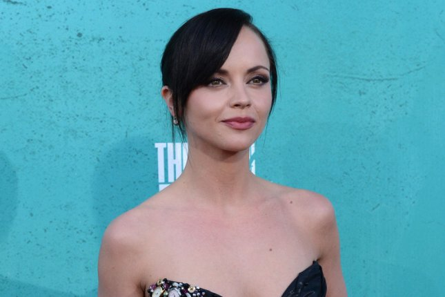 Actress Christina Ricci arrives at the MTV Movie Awards at the Gibson Amphitheatre in Universal City, Calif., on June 3, 2012. A recent photoshopped photo of Ricci -- former Addams Family actress -- as matriarch Morticia Addams, caught the Internet by surprise this week. Photo by Jim Ruymen/UPI