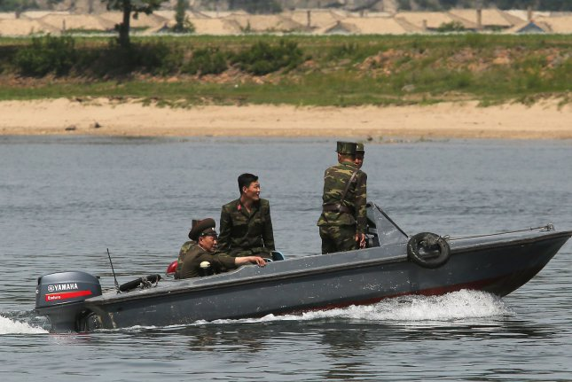 North Korean soldiers patrol the banks of the Yalu River near Sinuiju, across the Yalu River from Dandong, China's largest border city with North Korea. North Korea launched what appeared to be a mid-range Rodong missile Friday, local time, according to Seoul. Photo by Stephen Shaver/UPI