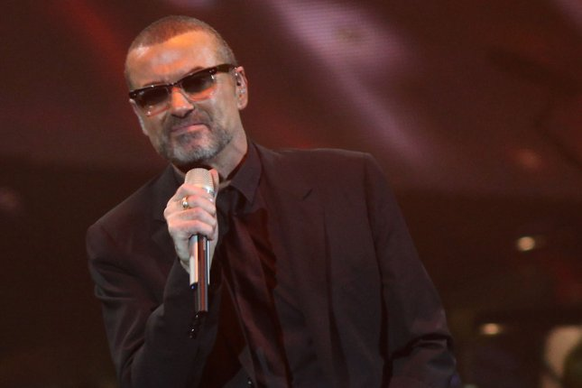 George Michael, accompanied by a symphony orchestra, performs in concert at Bercy in Paris on October 3, 2011. A coroner has unveiled Michael's cause of death. File Photo by David Silpa/UPI