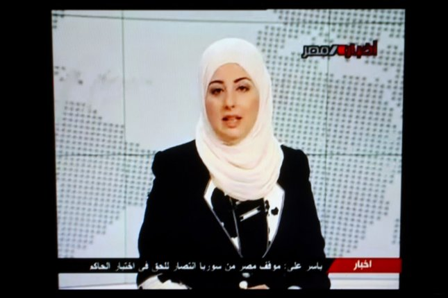 A screenshot of Egyptian television news anchor Fatma Nabil, wearing a hijab, or Muslim headscarf, while at work. A European Court of Justice ruling Tuesday said an internal workplace rule prohibiting visible signs of religion or philosophy does not constitute discrimination. UPI File photo