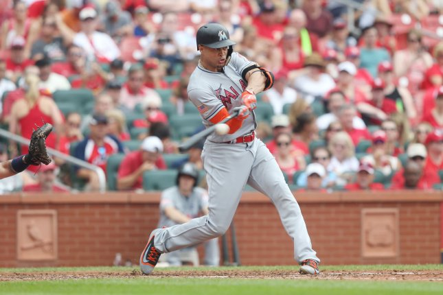 Miami Marlins' Giancarlo Stanton connects for a home run. File photo by Bill Greenblatt/UPI
