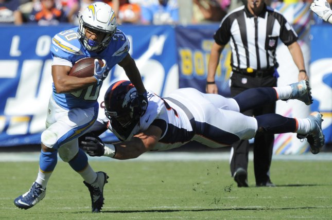 Los Angeles Chargers Austin Ekeler gets away from Denver Broncos Derek Wolfe in the first half at the StubHub Center in Carson, California on October 22, 2017. File photo by Lori Shepler/UPI