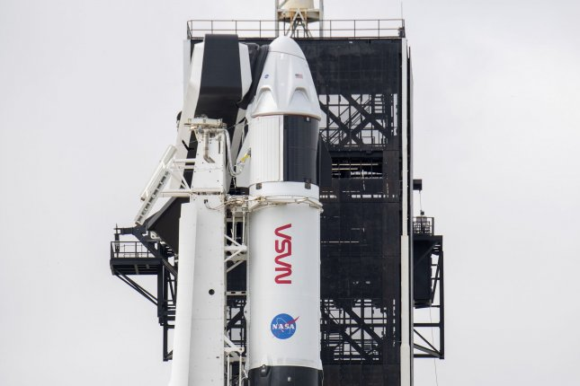 A SpaceX Falcon 9 rocket is shown Friday as it is prepared to launch four astronauts Sunday evening to the International Space Station from Kennedy Space Center in Florida. Photo by Pat Benic/UPI