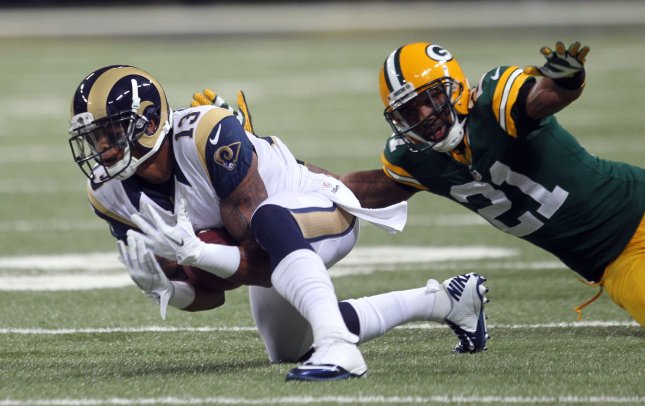 St. Louis Rams Chris Givens catches the football in front of Green Bay Packers defensive back Charles Woodson at Edward Jones Dome in St. Louis, Oct. 21, 2012. UPI/Bill Greenblatt