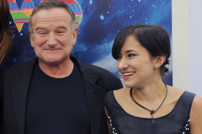 Robin Williams with daughter Zelda Williams at Grauman's Chinese Theatre in the Hollywood section of Los Angeles for the premiere of Happy Feet Two. UPI/Jim Ruymen