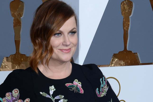 Actress Amy Poehler arrives on the red carpet for the 88th Academy Awards in Los Angeles on February 28, 2016. File Photo by Jim Ruymen/UPI