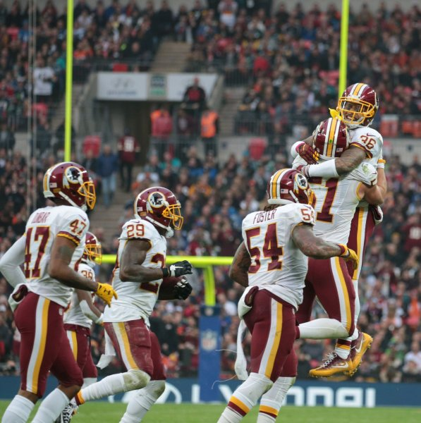 Washington Redskins Dashaun Phillips celebrates an interception in the match against the Cicinnati Bengals in the third game of the International Series at Wembley Stadium, London on October 30, 2016.The match was tied after overtime 27-27. Photo by Hugo Philpott/UPI.
