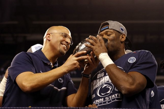 Penn State Nittany Lions head coach James Franklin has Malik Golden kiss the trophy after the defeated the Wisconsin Badgers 38-31 in the 2016 Big Ten Football Championship Game in Indianapolis on December 3, 2016. File photo by John Sommers II/UPI