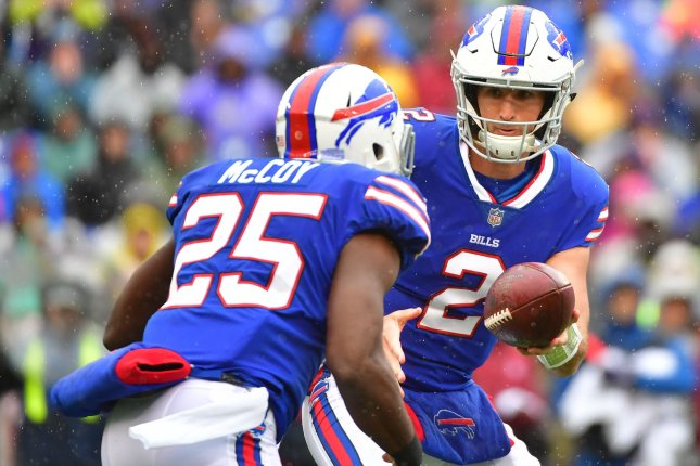 Buffalo Bills quarterback Nathan Peterman (2) hands off to running back LeSean McCoy (25) on September 9 at M&T Bank Stadium in Baltimore. Photo by Kevin Dietsch/UPI