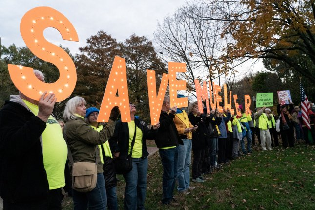 Protestors gather at Lafayette Park in front of the White House for a campaign rally to Protect Mueller on Thursday. Photo by Ken Cedeno/UPI