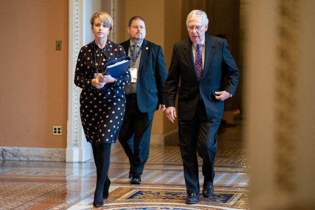 Senate Republican leader Mitch McConnell walks into the Senate chamber for the continuation of the Senate impeachment trial of President Donald Trump on Wednesday. Photo by Ken Cedeno/UPI
