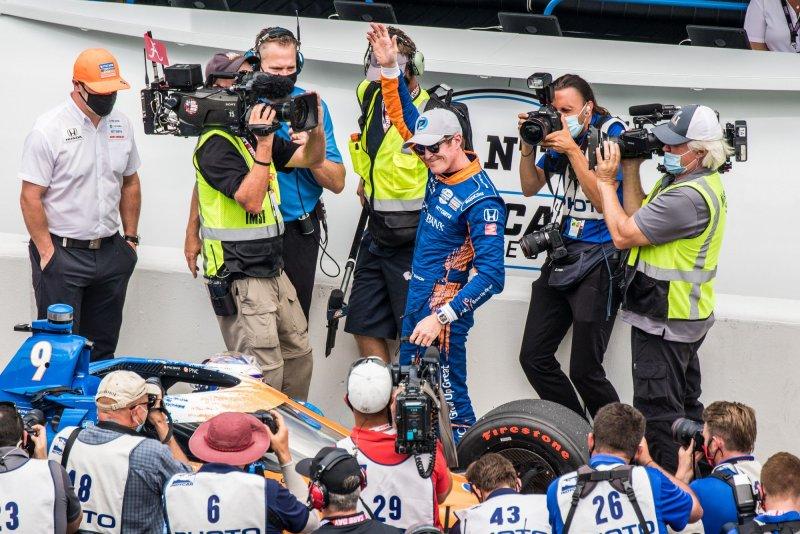 Scott Dixon (C) celebrates after winning the pole for the 2021 Indianapolis 500 on Sunday in Indianapolis. Photo by Edwin Locke/UPI
