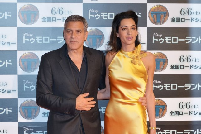 Actor George Clooney and his wife Amal attend the premiere for the film Tomorrowland in Tokyo, Japan on May 25, 2015. File Photo by Keizo Mori/UPI