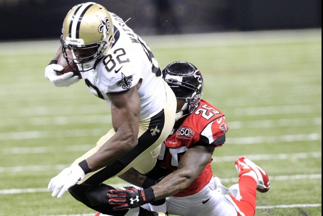 New Orleans Saints tight end Benjamin Watson (82) takes a Drew Brees pass 17 yards before Atlanta Falcons strong safety William Moore (25) can make the stop during the third quarter at the Mercedes-Benz Superdome in New Orleans October 15, 2015. Photo by AJ Sisco/UPI