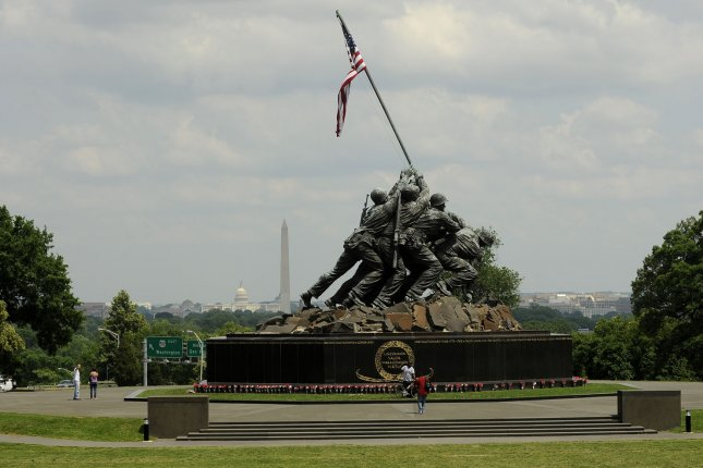 Visitors pass by the U.S. Marine Corps' Iwo Jima Memorial in Arlington, Va., which is modeled after a famous photograph taken by press photographer Joe Rosenthal during World War II's Battle of Iwo Jima on Feb. 23, 1945. Thursday, the Marine Corps acknowledged that a review has found that one of the men who's always been identified in the photo actually does not appear in it. The soldier officials had always thought to be the man, John Bradley is, in fact, Harold Schultz, the USMC said. File Photo by Roger L. Wollenberg/UPI