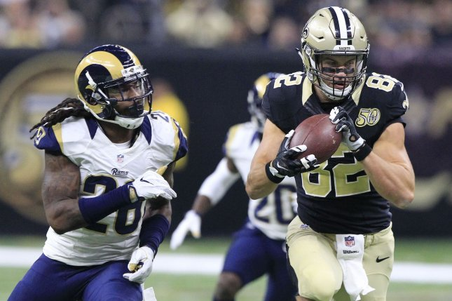 New Orleans Saints tight end Coby Fleener (82) grabs a Drew Brees pass in front of Los Angeles Rams outside linebacker Mark Barron (26) for a 31 yard gain in the second quarter at the Mercedes-Benz Superdome in New Orleans November 27, 2016. Photo by AJ Sisco/UPI