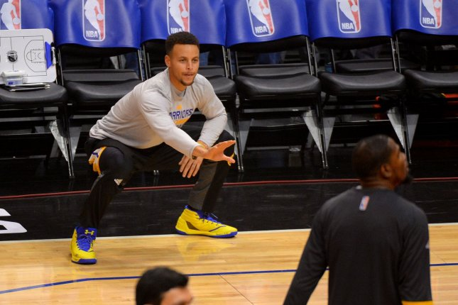 Stephen Curry combined with Klay Thomspon as the Golden State Warriors scored a 113-106 victory over the stubborn Houston Rockets at Toyota Center. File Photo by Jon SooHoo/UPI