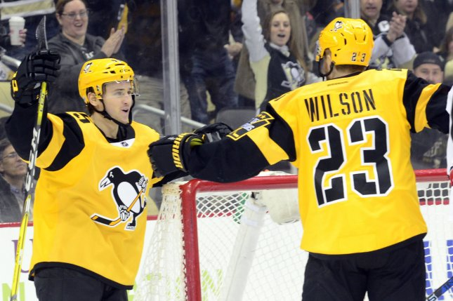 Pittsburgh Penguins left wing Scott Wilson (23) celebrates his goal with right wing Josh Archibald (45) agaonst the Carolina Hurricanes in the second period at the PPG Paints Arena in Pittsburgh on April 2, 2017. File photo by Archie Carpenter/UPI