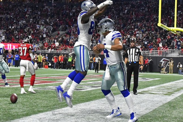 Former Dallas Cowboys wide receiver Dez Bryant (L) said the NFC East franchise should have agreed to a contract extension with quarterback Dak Prescott (R) as soon as the 2019 regular season ended. File Photo by David Tulis/UPI